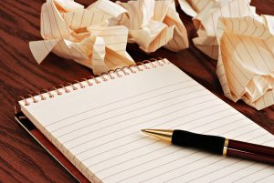bigstock_Blank_notepad_with_ink_pen_on__15024992-2